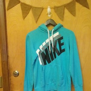 Turquoise Nike hoodie. Size M Womens